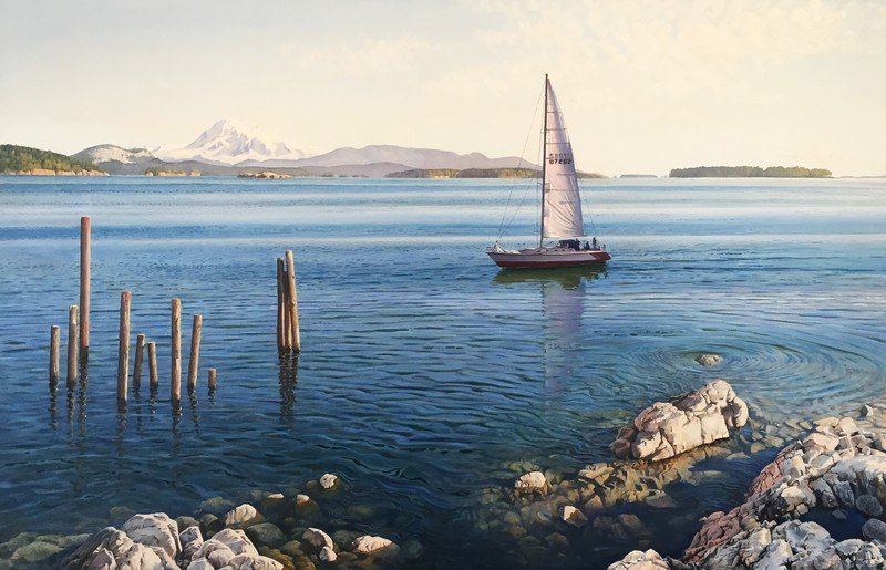 A sailing boat glides by Mount Baker in the Salish Sea.