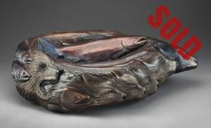 Large bronze bowl depicting bears, wolves and salmon