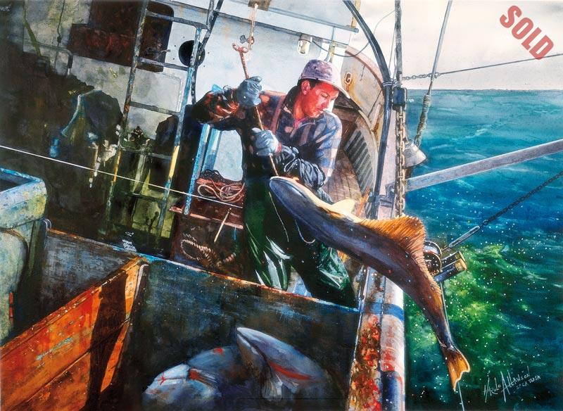 A steel fishing boat heels over on the open sea as a fisherman brings a large halibut over the side with a hook.
