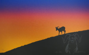 A mountain goat stands silhouetted on a hill in front of an orange sky
