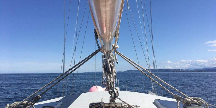 The bow of the Achiever on a blue sky day.