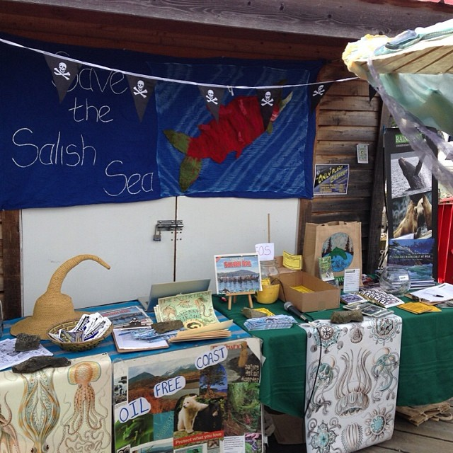 Table with posters, and information sheets and a banner that reads Save The Salish Sea