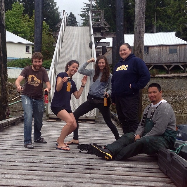 Five young members of Raincoast staff bear research team posing on a dock in Bella Bellla
