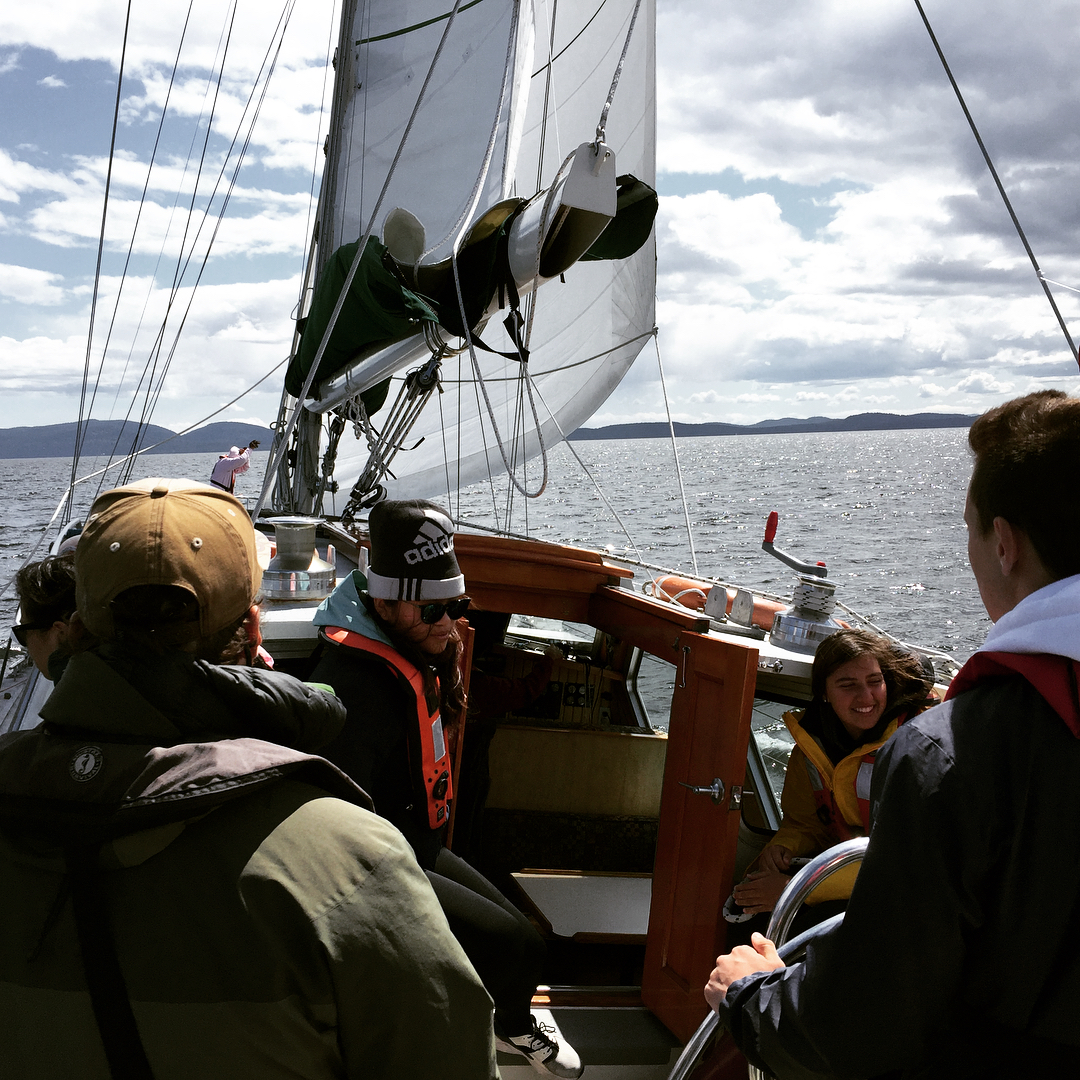 A team of emerging stewards share a laugh on a windy day aboard the Achiever.