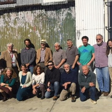 Photograph of various men and women standing in a row, and kneeling in a row in front, including Raincoast biologist Misty MacDuffee and Patagonia founder Yvon Chouinard