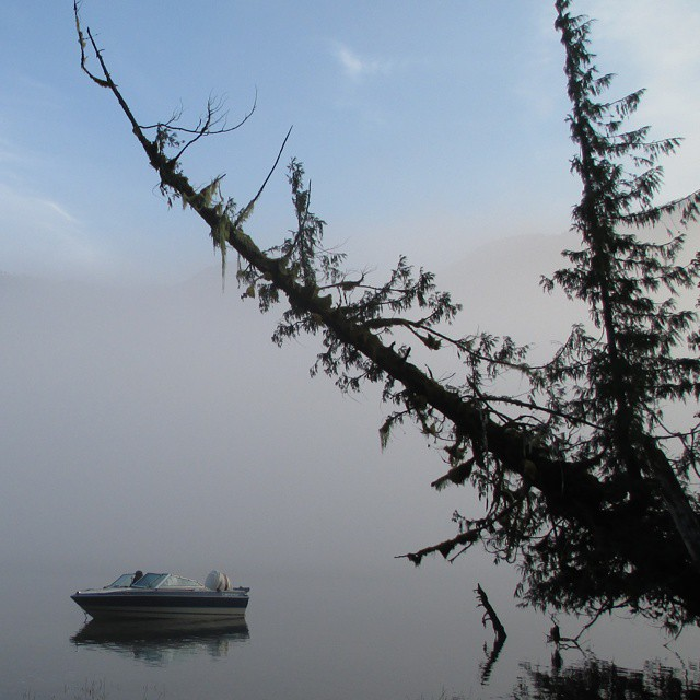 boat in the waters of Wuikinuxv lake in the early morning