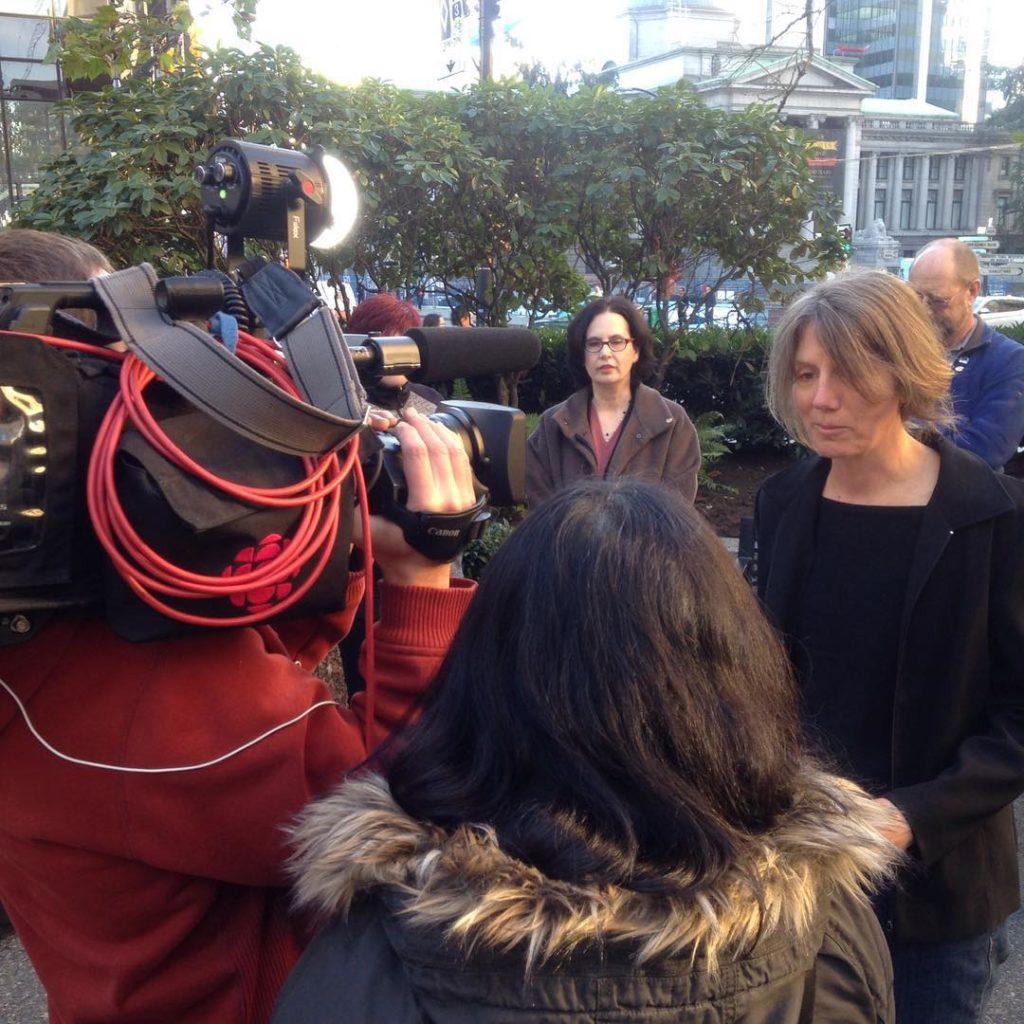 Raincoast staff biologist Misty Macduffee speaks to reporters outside the court
