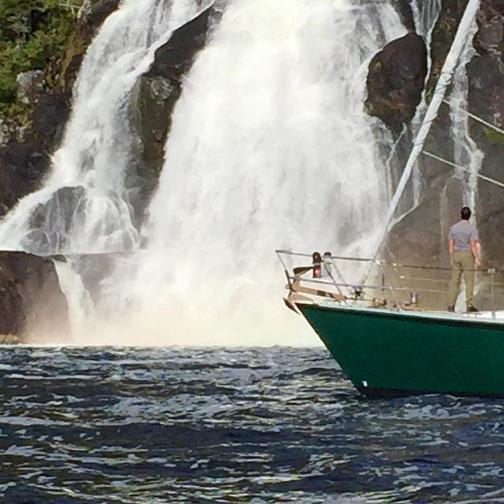 Achiever, the boat approaches very close to a waterfall