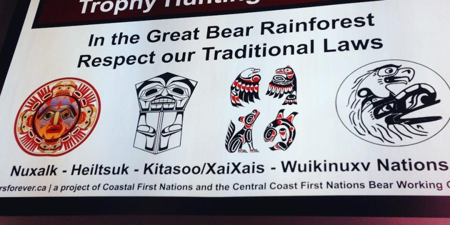 "A sign in the Vancouver terminal supplied by Coastal First Nations that reads ""Trophy Hunting is Closed in the Great Bear Rainforest. Respect our traditional laws. Nuxalk, Heiltsuk, Kitasoo/Xai'xai, Wuikinuxv,"