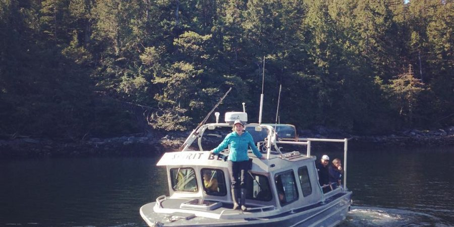 a boat in the water in the Freat Bear Rainforest carrying research crew from the Spirit Bear Research Foundation