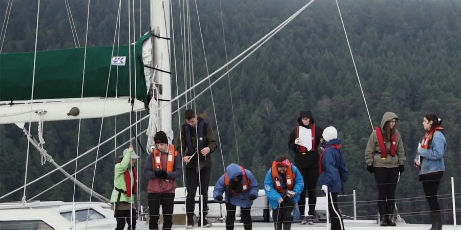 A group of students from the Salish Sea Emerging Stewards program hangout on the Achiever