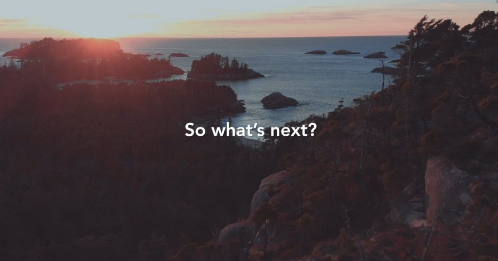 """An arial shot of a rocky, mountainous landscape with the sun rising over the ocean in the distance. """"So what's next?"""" printed over top."""