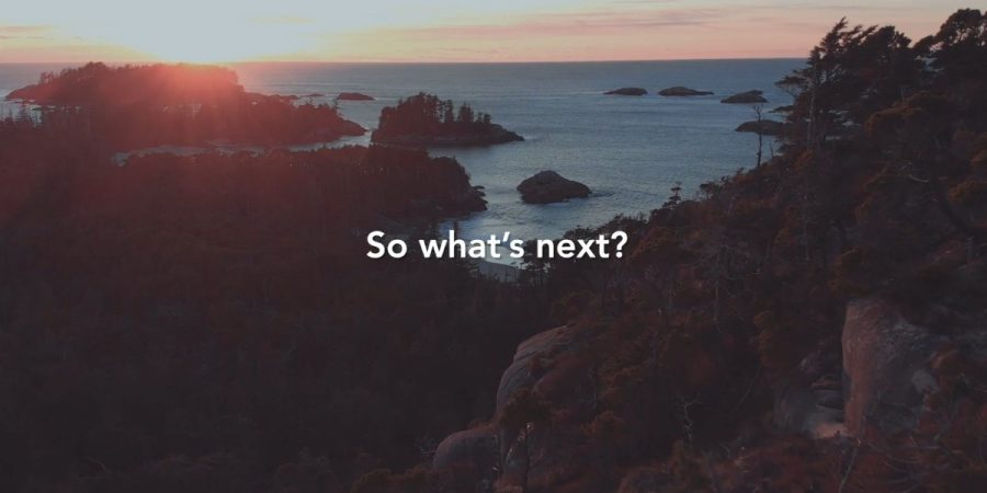 "An arial shot of a rocky, mountainous landscape with the sun rising over the ocean in the distance. ""So what's next?"" printed over top."