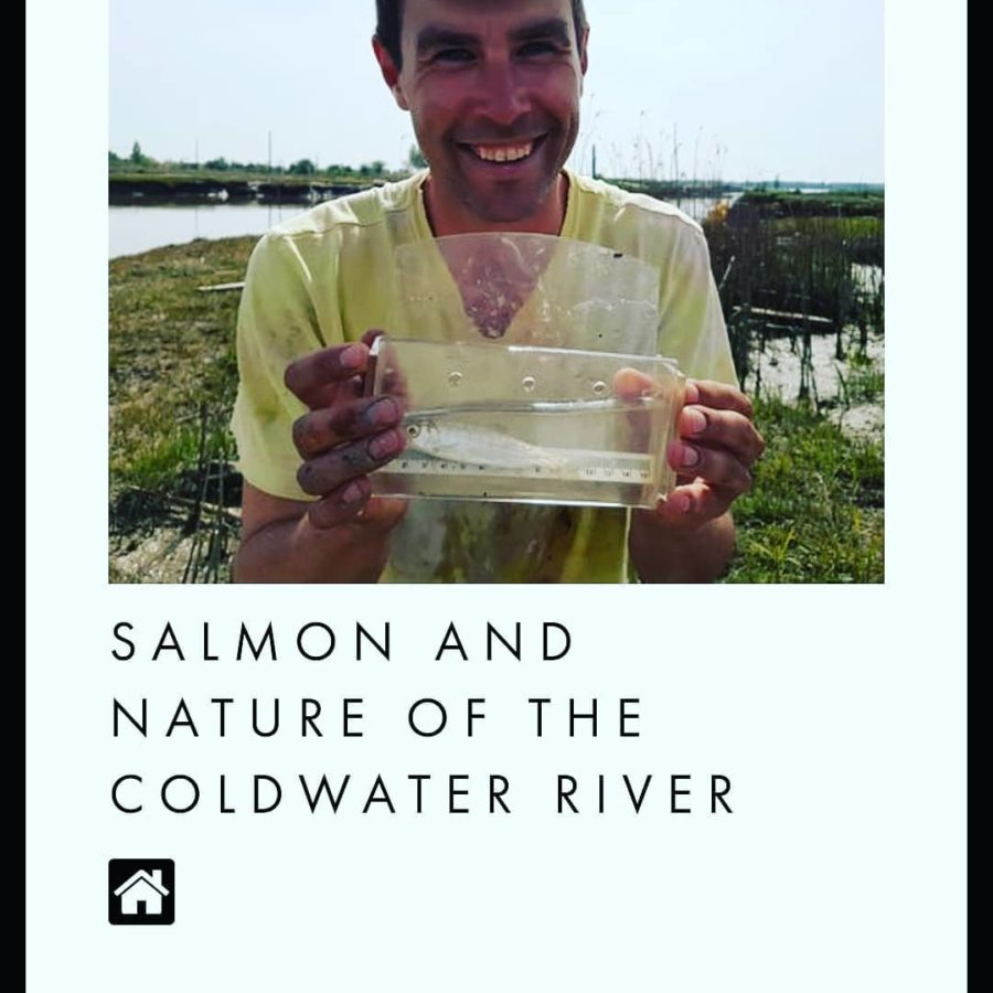 "A picture of Dave holding a tub of water with a silver fish in it, and beaming. Underneath it reads ""Salmon and Nature of the Coldwater River."""