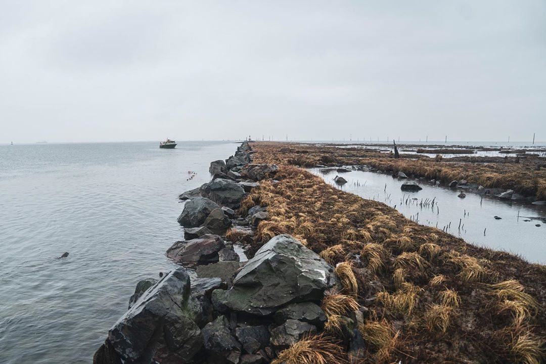 One part of Steveston jetty with boulders piled up damming the water